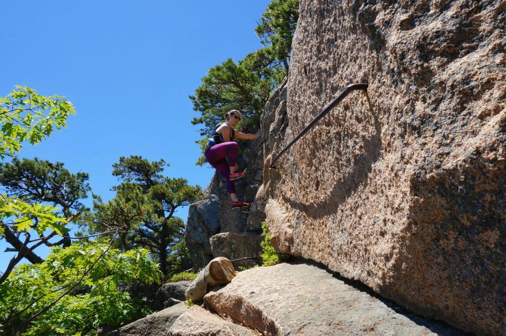 Climbing up the iron rungs.