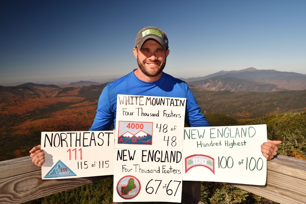 Peter Barr, all smiles as he finishes four lists at once on top of Mount Carrigain. | Courtesy of Peter Barr