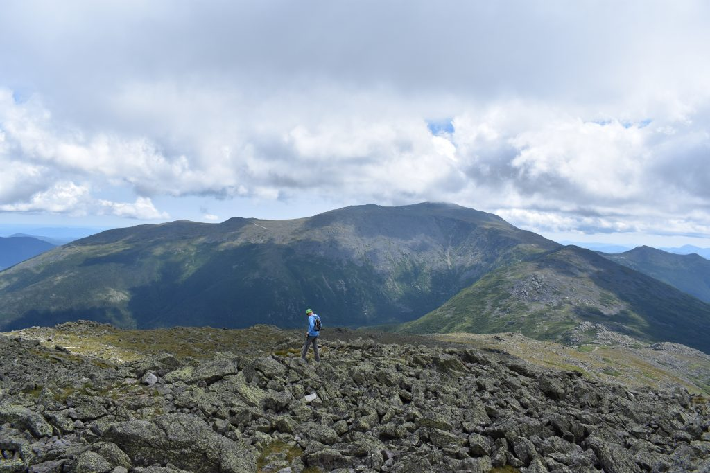 Descending Mount Jefferson with Mount Washington in the background. | Credit: Tim Peck