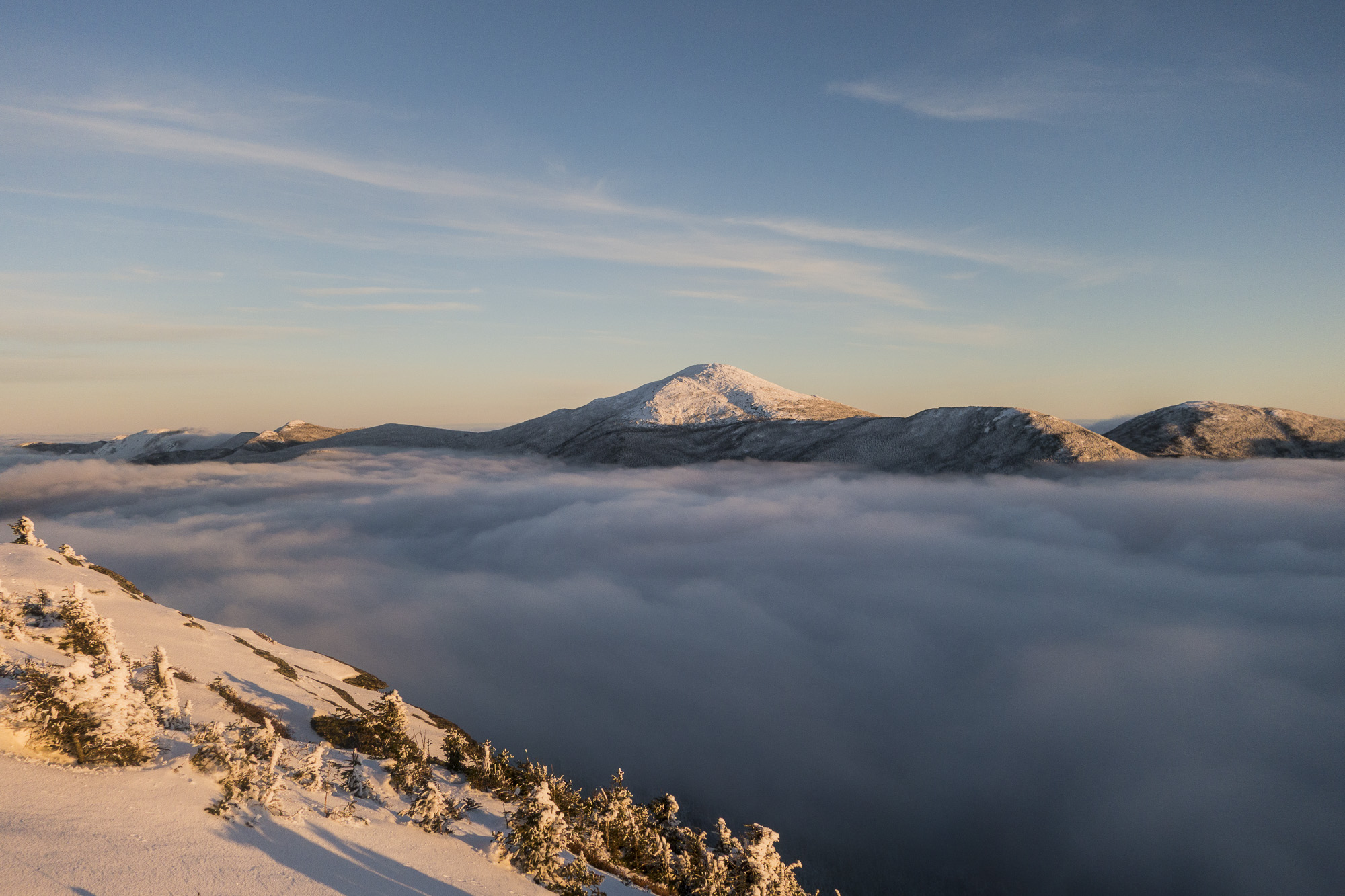 Mount March through an undercast from Colden's summit. | Credit: Ryan Wichelns