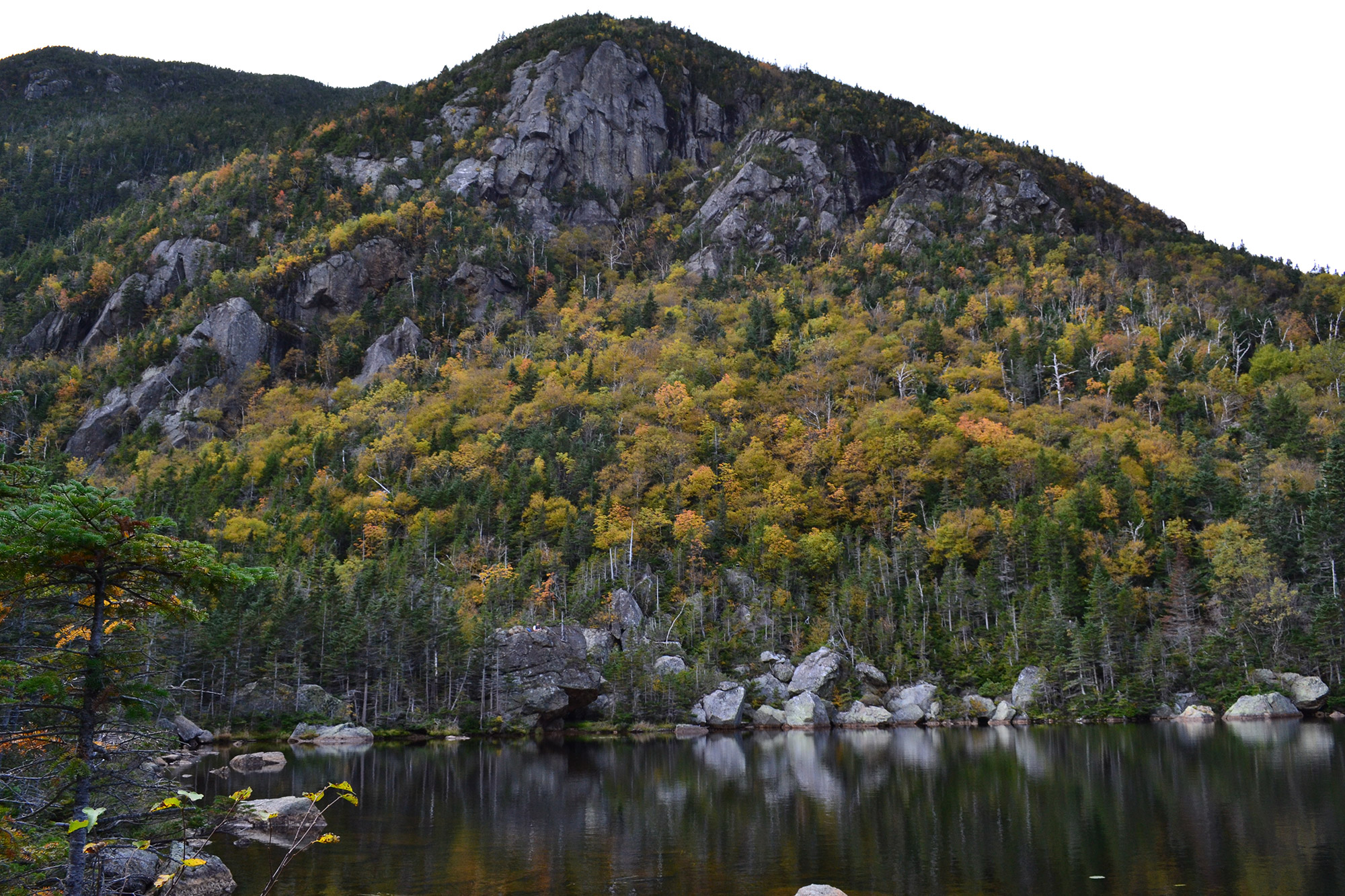 Fall foliage behind Carter Lake. | Credit: Douglas Martland