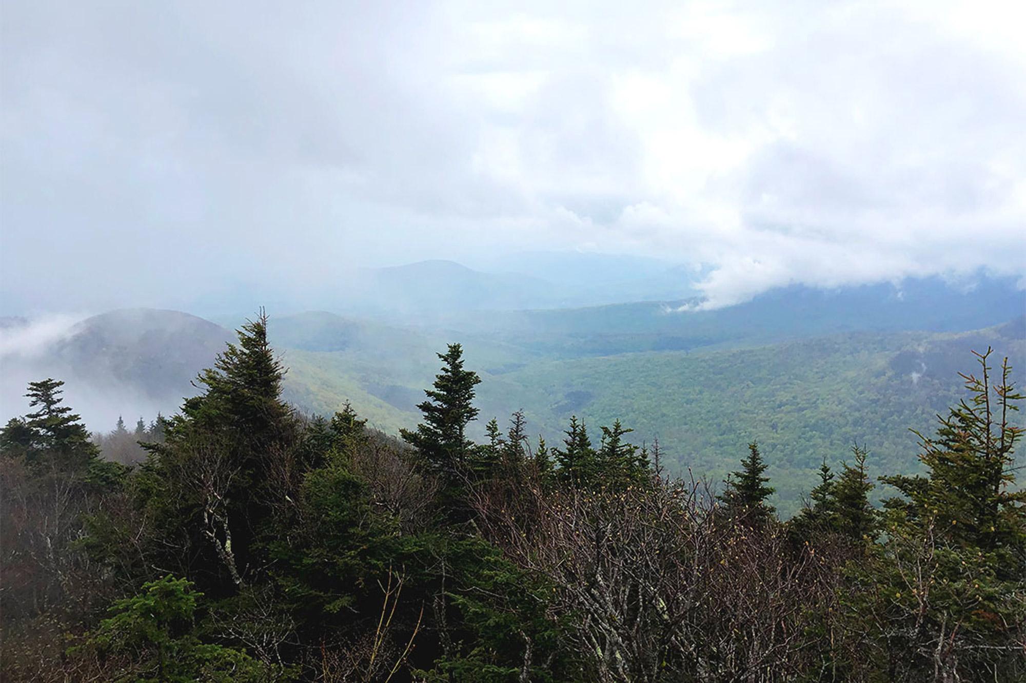 A break in the clouds from Twin Mountain's south summit.   Credit: John Lepak