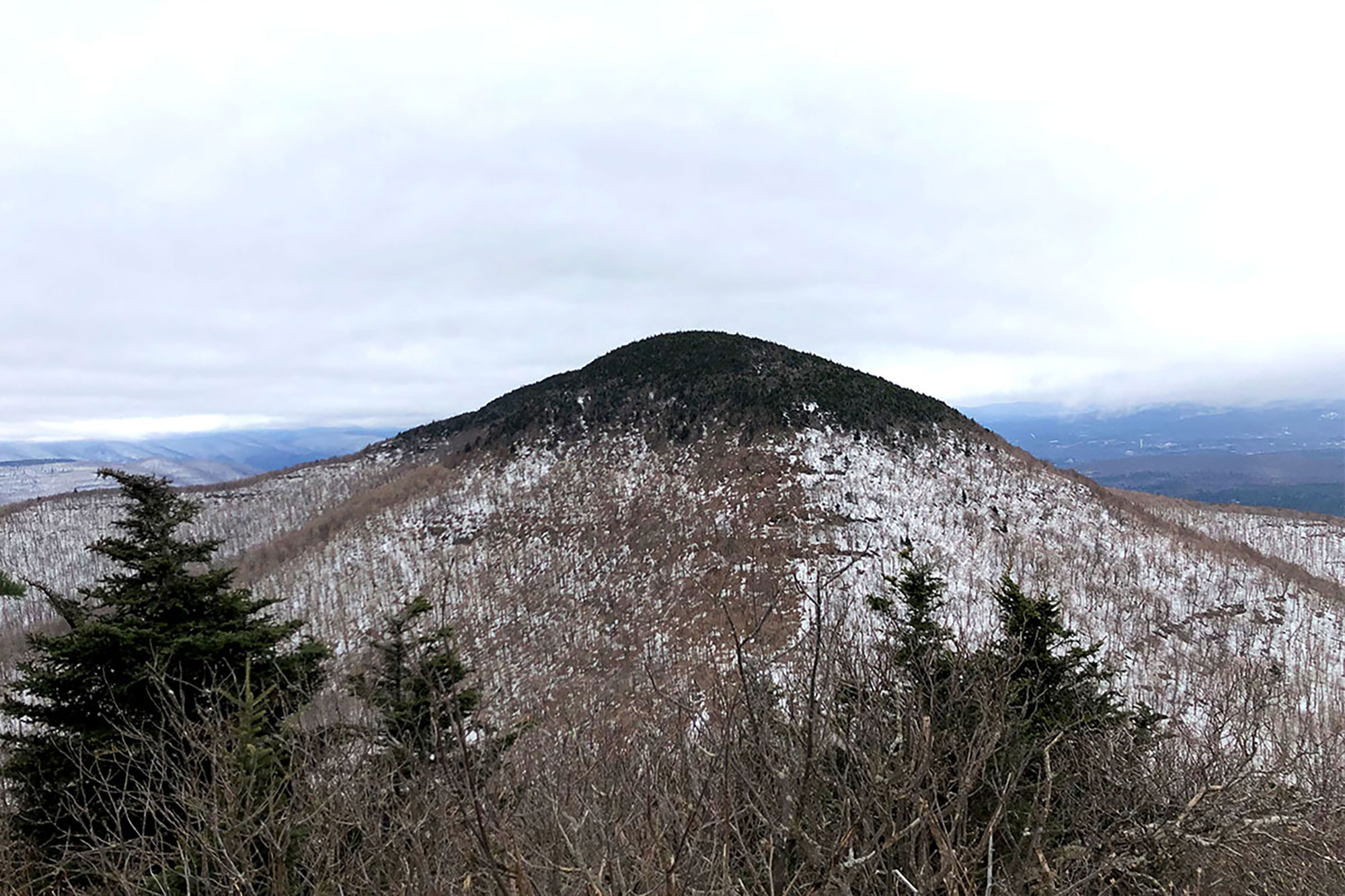 Black Dome Mountain is front-and-center while descending from Blackhead's viewless summit.   Credit: John Lepak