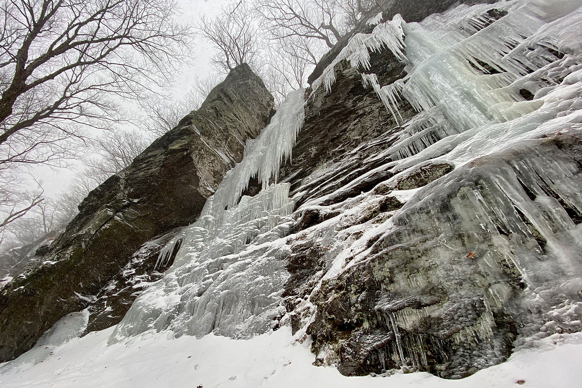Looking up at the long, right-facing corner of Little Black Dike (WI4-), the area's classic route.   Credit; John Lepak