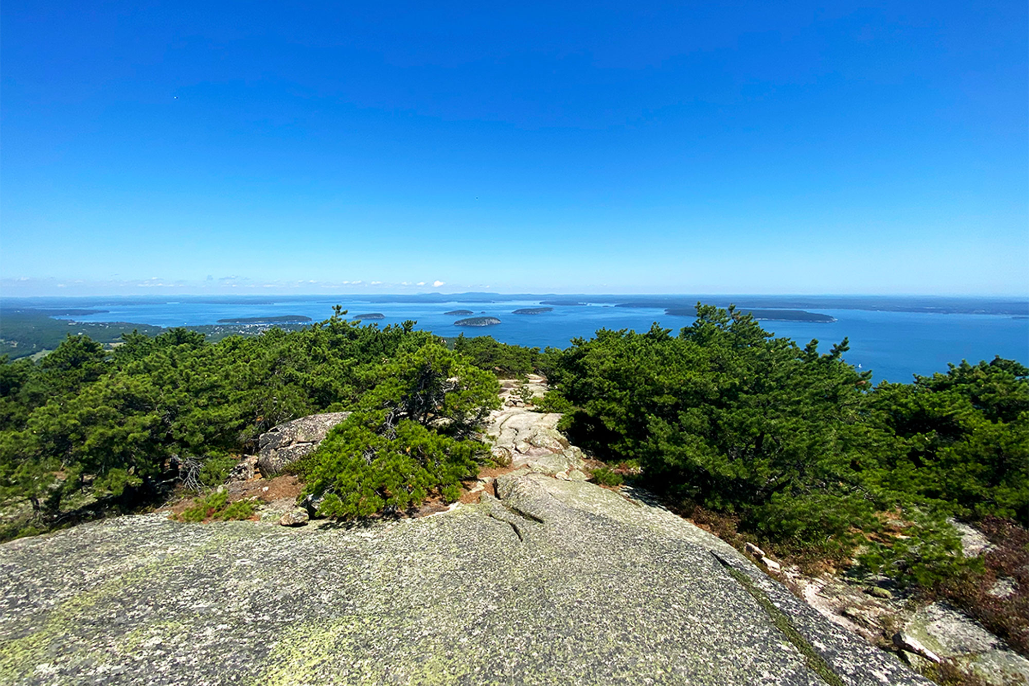 A view of Frenchman Bay and the Porcupine Islands while descending Champlain's North Ridge. | Credit: John Lepak