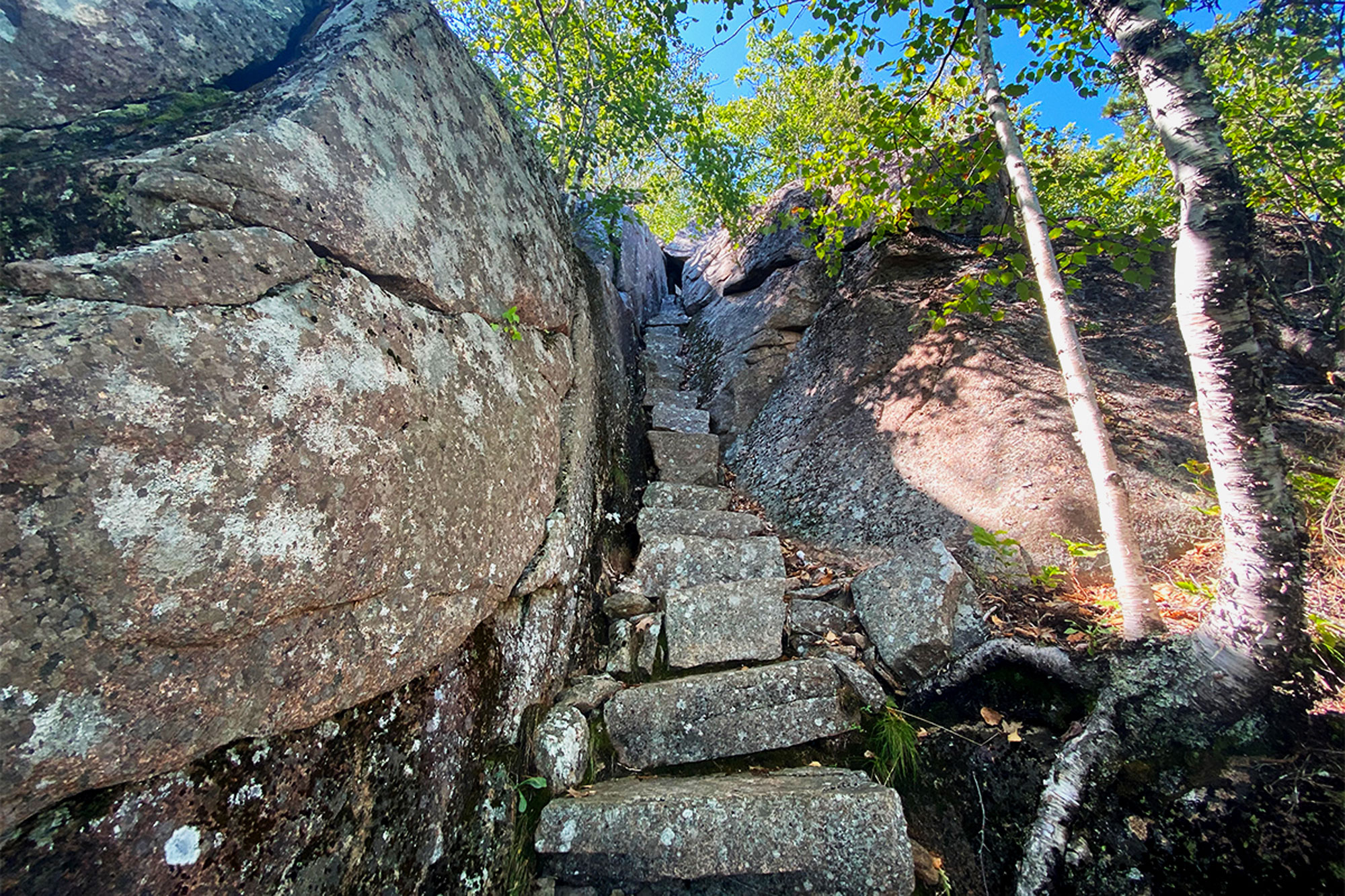 Narrow stone steps and some scrambling are a reminder that you're not out of the woods yet on the Orange and Black Path. | Credit: John Lepak