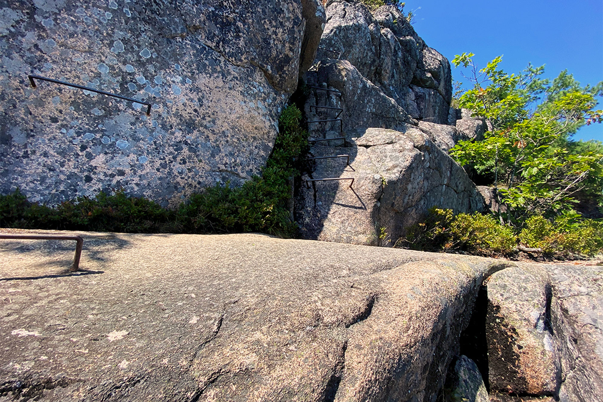 Iron rungs mark the route on the upper reaches of the Precipice Trail.   Credit: John Lepak